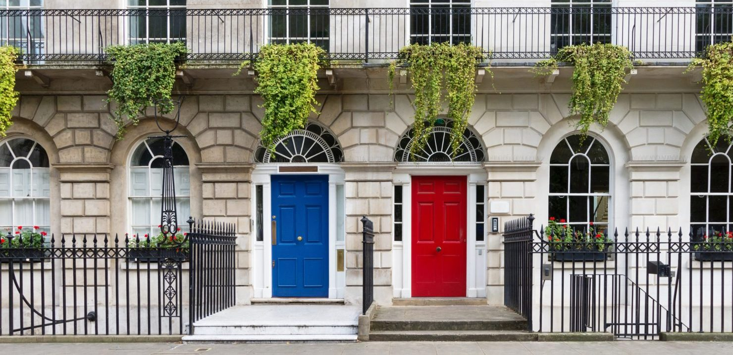 Town house with red and blue door