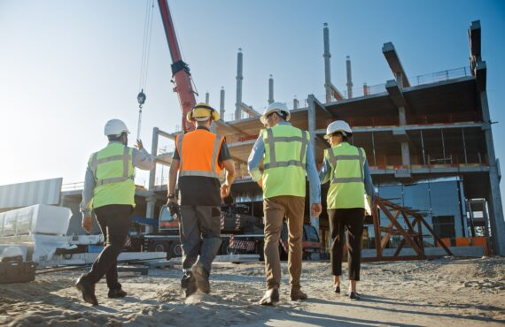 Diverse Team of Specialists Inspect Commercial